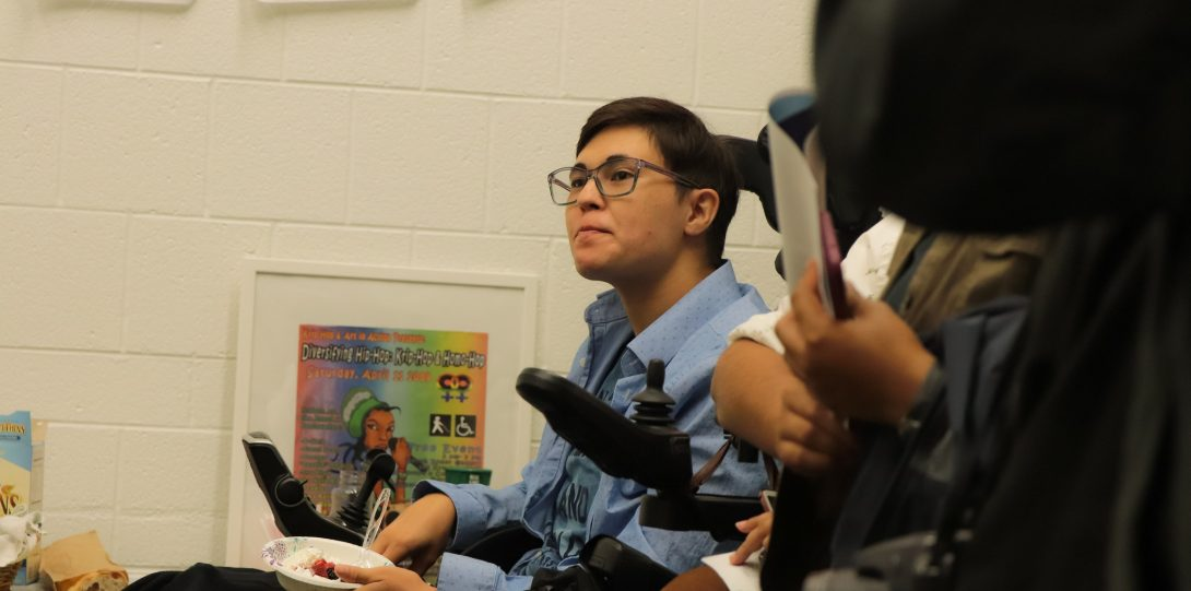 Student Noah Ohashi listening to and looking at someone speaking behind the camera.