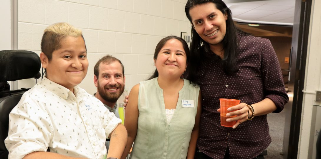 DRC Disability Specialist, Hugo Trevino, DCC Graduate Assistant Brian Heyburn, DCC Program Coordinator Lily Diego-Johnson, and GSC Assistant Program Director, Moisés Villada face the camera smiling.
